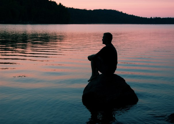 Man on rock meditating